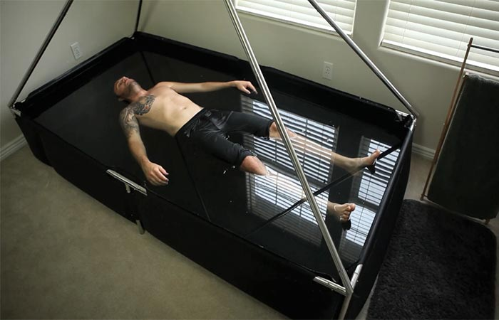 A guy floating in an isolation tank