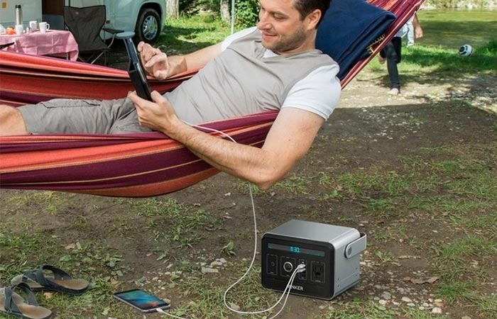 Anker Powerhouse charging a tablet and mobile while camping