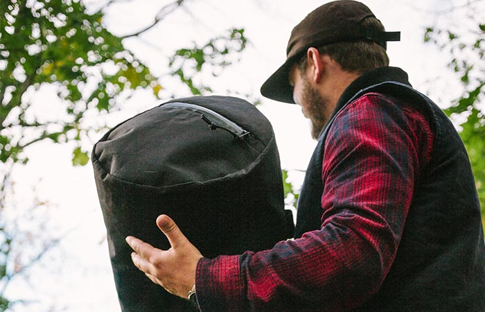 A Guy Carrying Black Stormproof Duffle