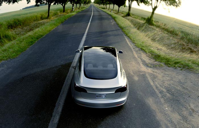Grey Tesla Model 3 From The Back