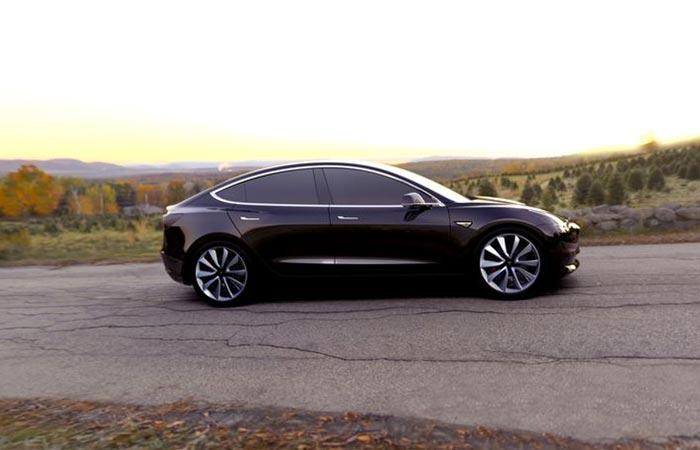 Black Tesla Model 3 On The Road