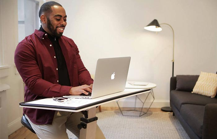 A Guy Sitting At The Edge Desk