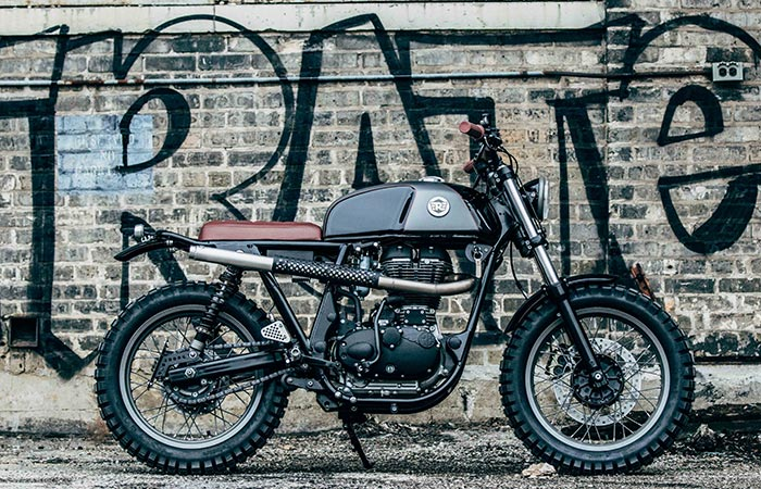 The Royal Enfield From The Side With Grafiti Behind