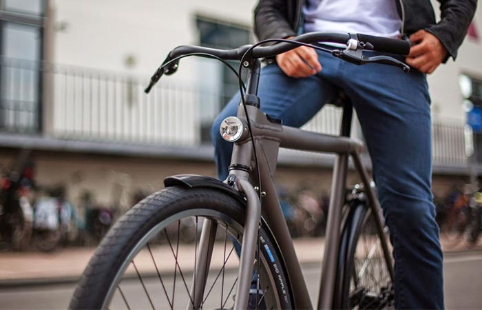 A Guy Sitting On VanMoof Electrified S