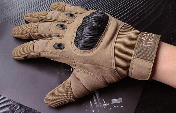 Reebow Gear Military Hard Knuckle glove on someones hand