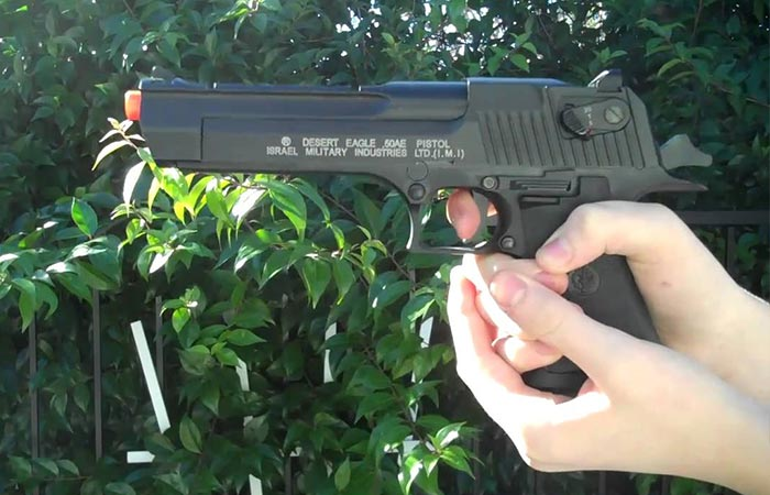 Desert Eagle airsoft pistol being held outside
