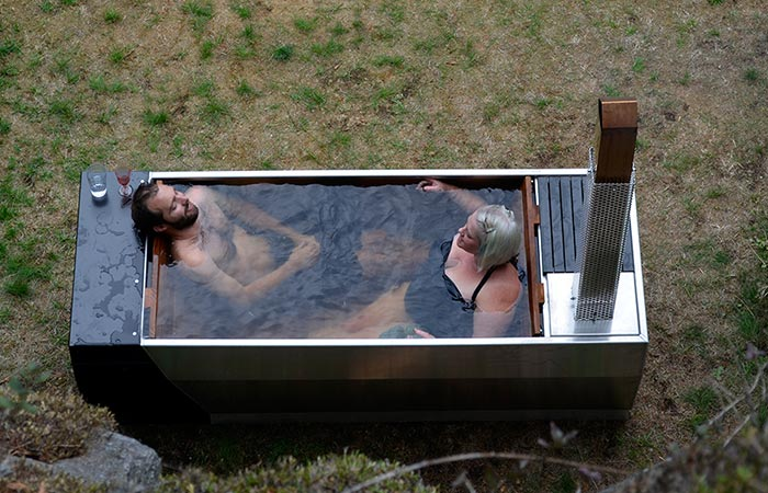 Two People Sitting In Soak Wood Fired Hot Tub