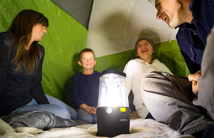 Family Insde A Tent Using CampGuard Perimeter Security Camping Lantern