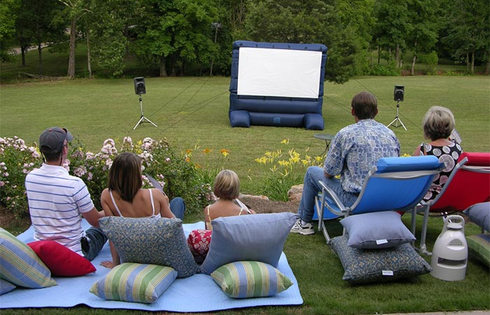People Outdoors Looking At Gemmy 12 Ft Inflatable Deluxe Movie Screen