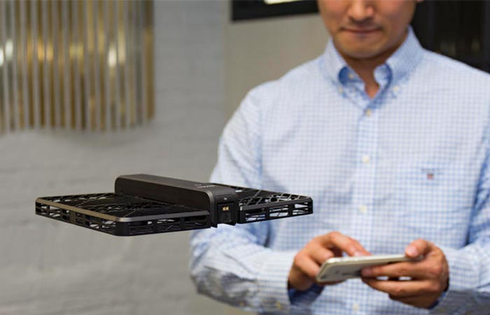 Man controlling Hover Camera with a smartphone