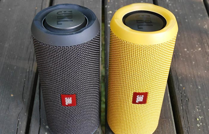 JBL Flip 3 black and yellow next to each other