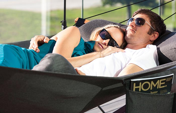 A Couple Using Lujo Living Free-standing Double Hammock