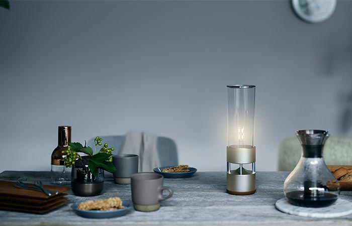 Sony Glass Sound Speaker On A Table With More Things On It