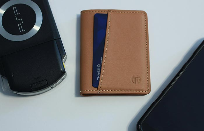 Tan Bifold Tyni Wallet next to PSP
