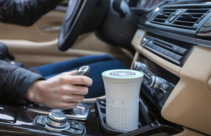 Wynd Personal Air Purifier Placed Inside A Car