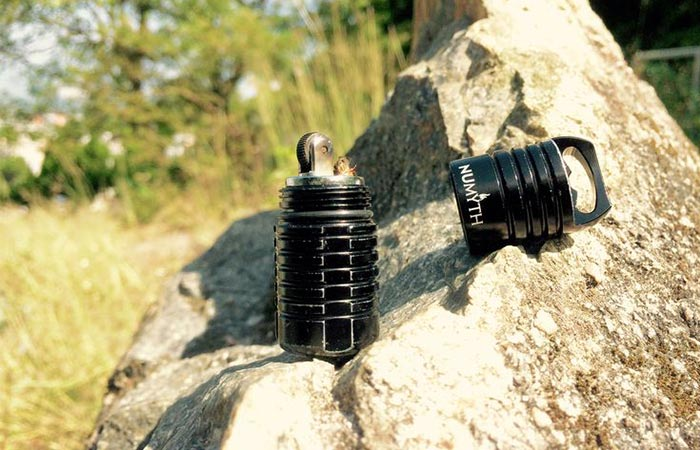 Numyth Tohil v2 Watertight Fluid Lighter On A Rock