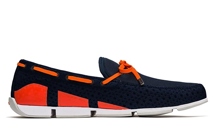 Side view of navy and orange SWIMS Breeze