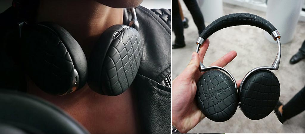 Parrot Zik 3.0 around someone's neck and someone holding a pair.
