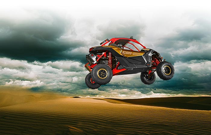 Can-Am Maverick X3 flying through the air