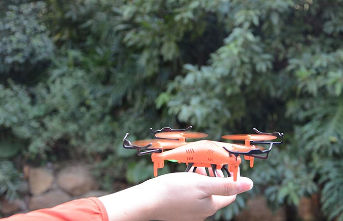 GPTOYS F51C RC Quadcopter being held in someone's hand