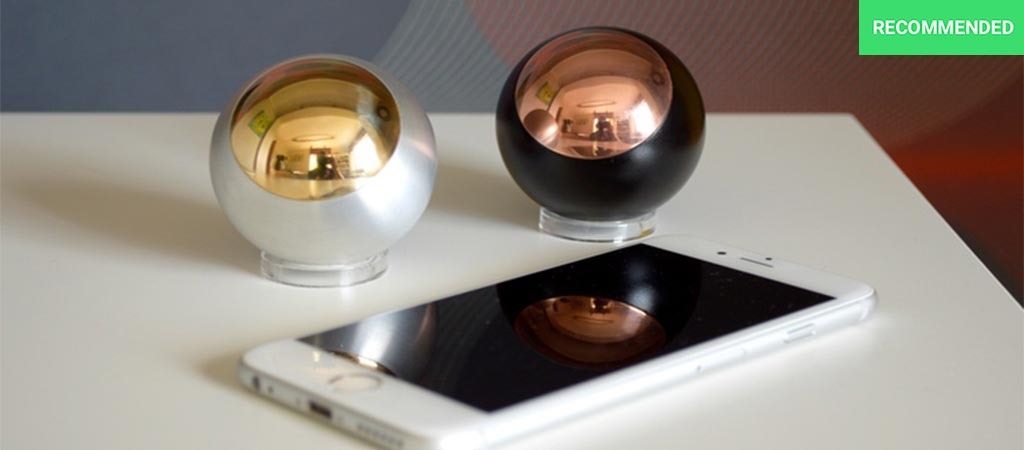 Two different Gr2 Spheres next to a mobile phone on desk