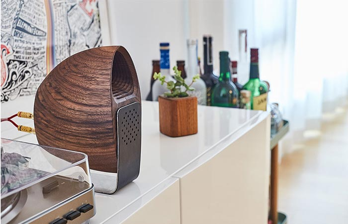 Grovemade Walnut Speakers On A White Shelf