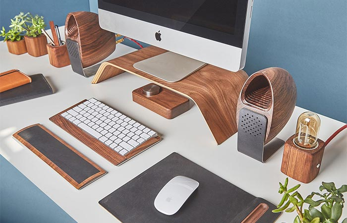Grovemade Walnut Speakers On The Desk With Other Grovemade Products