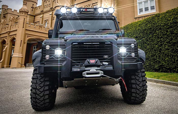 Land Rover Defender 90 Spectre Edition standing outside with lights on