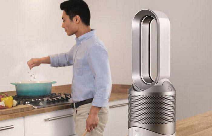A Guy Coking With Dyson Pure Hot+Cool Link Next To Him