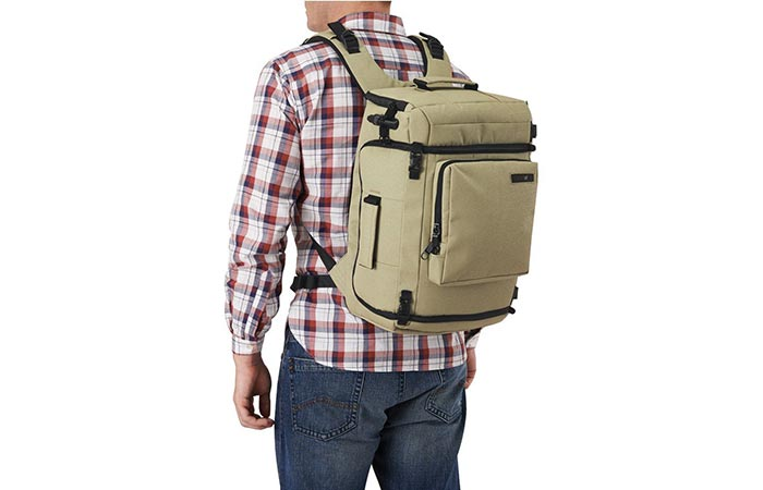 A Guy Waring Slate Green Pacsafe Camsafe Z25 Anti-Theft Camera And Laptop Backpack