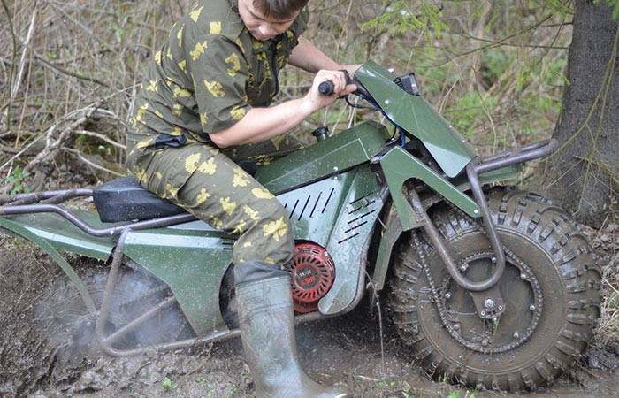 Man using the Taurus 2x2 in mud