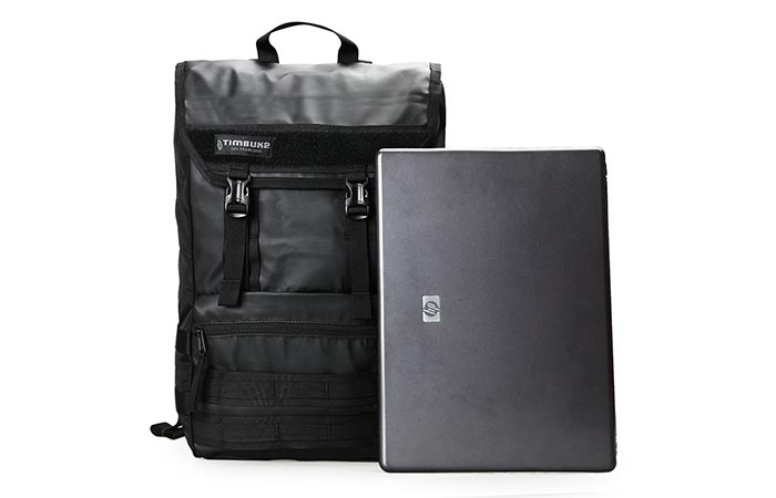 Timbuk2 Rogue Laptop Backpack next to a laptop