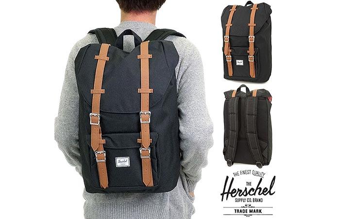 Man wearing the Herschel Little America Backpack