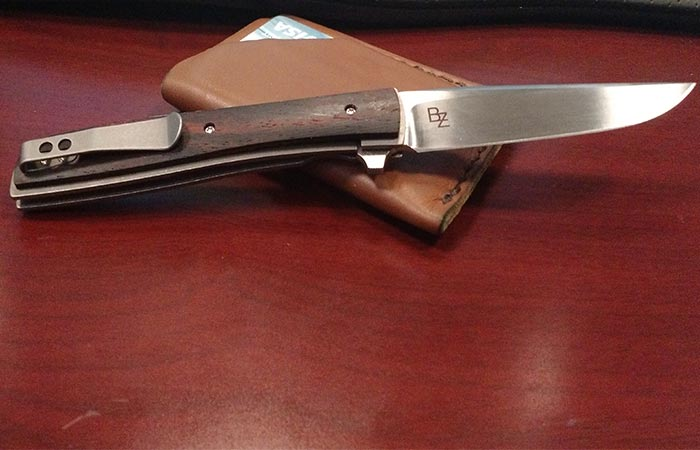 Boker Plus Urban Trapper with cocobolo handle on a desk