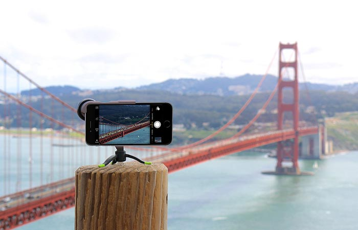 Smartphone a bracket taking a photo of the Golden Gate bride with the ExoLens on a tripod