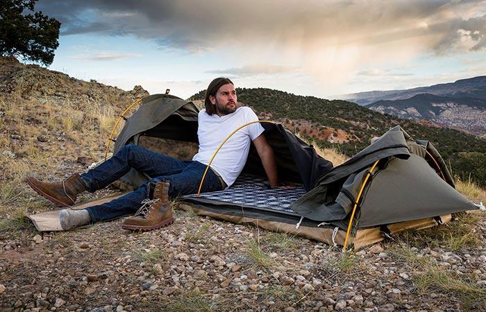 Man sitting on his Kodiak Canvas