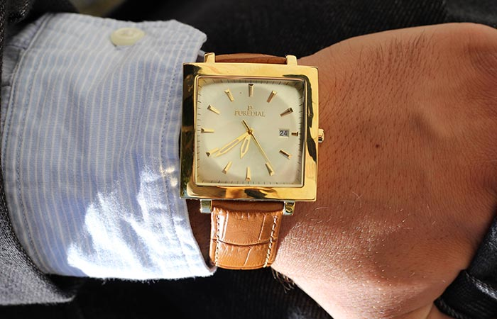 Puredial Square Legacy Gold on a man's wrist