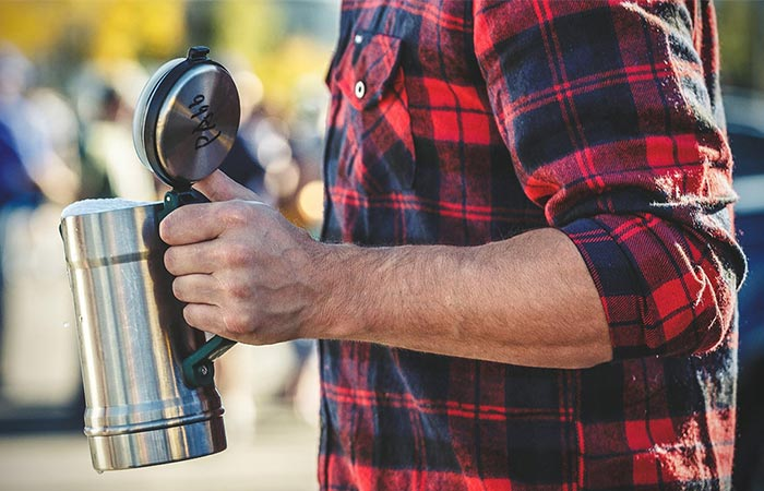 A Guy Holding Stanley Vacuum Insulated Stein