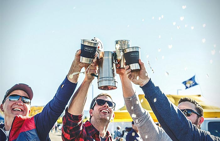 Four Guys Holding Stanley Cups And Stanley Vacuum Insulated Stein
