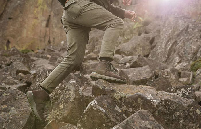 A Guy Climbing Rocks In Danner Mountain 600 Hiking Boots