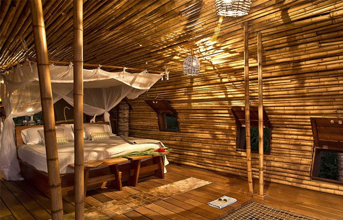 a bed in one of the rooms in Playa Viva hotel complex