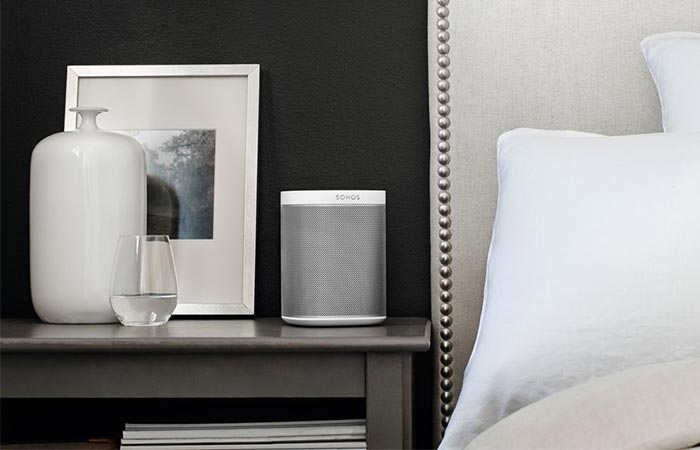 White Sonos Play 1 Next To A Bed