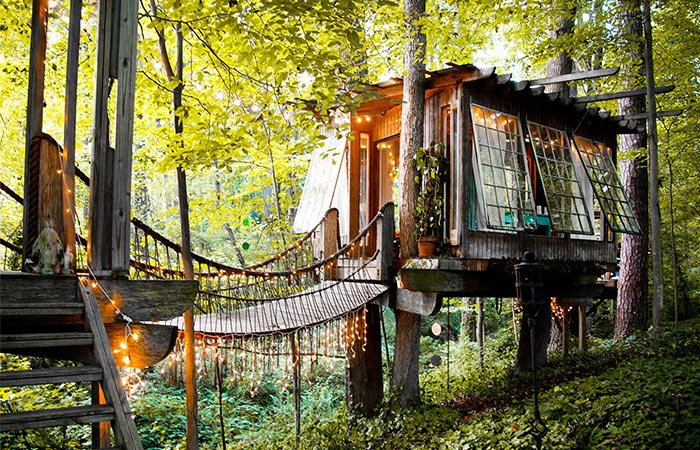 a treehouse in the woods