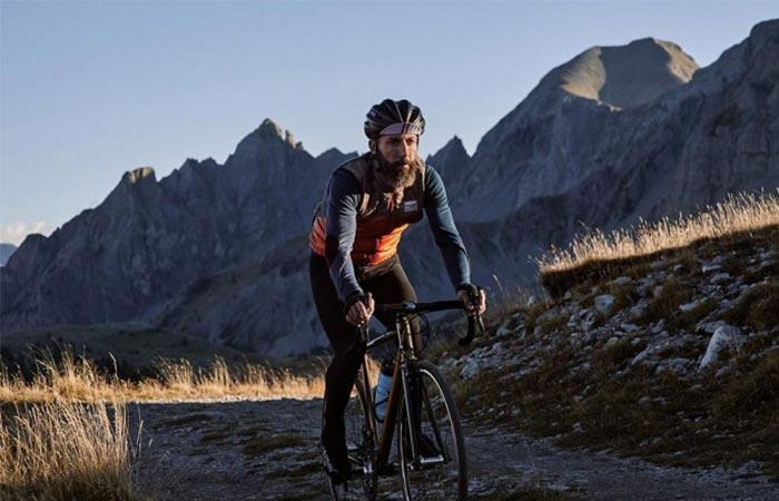 a guy on a bik wearing orange Albertine Thermal Cycling Vest
