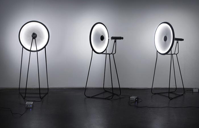 three black hole lamps shining