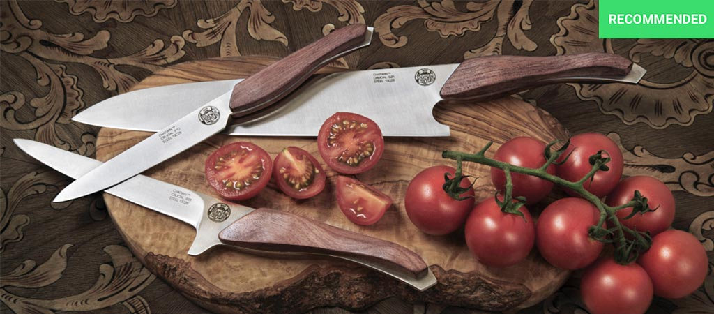 The three different knives in the Chatwin Crucial set on a cutting board with tomatoes