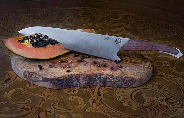 Chatwin Crucial Chef's Knife cutting into a pawpaw.