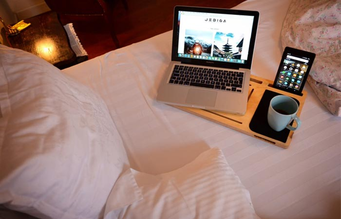 LapPad GO+ with gadgets on the bed