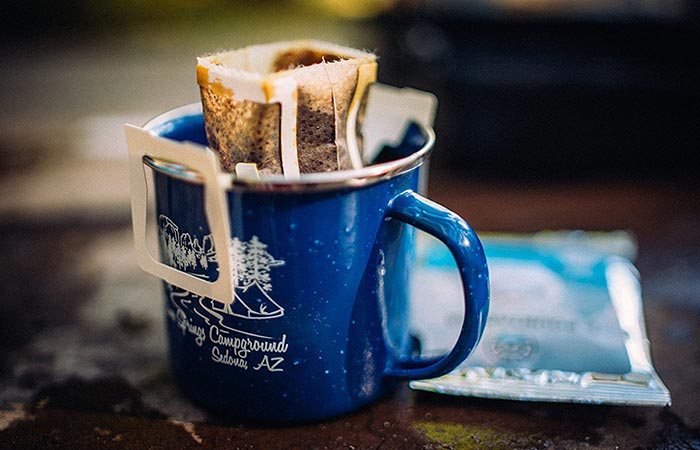 Coffee made in a blue mug.