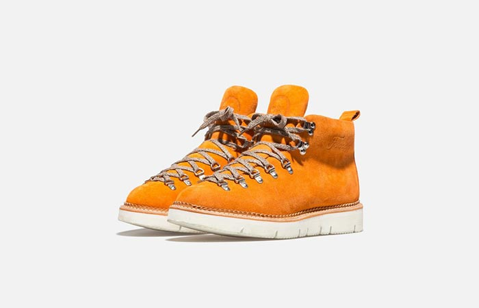 a pair of orange hiking boots